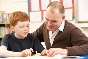 http://www.dreamstime.com/royalty-free-stock-photos-male-pupil-studying-classroom-teacher-image18030088